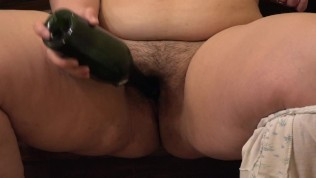 Fat girl masturbates her hairy pussy with a bottle